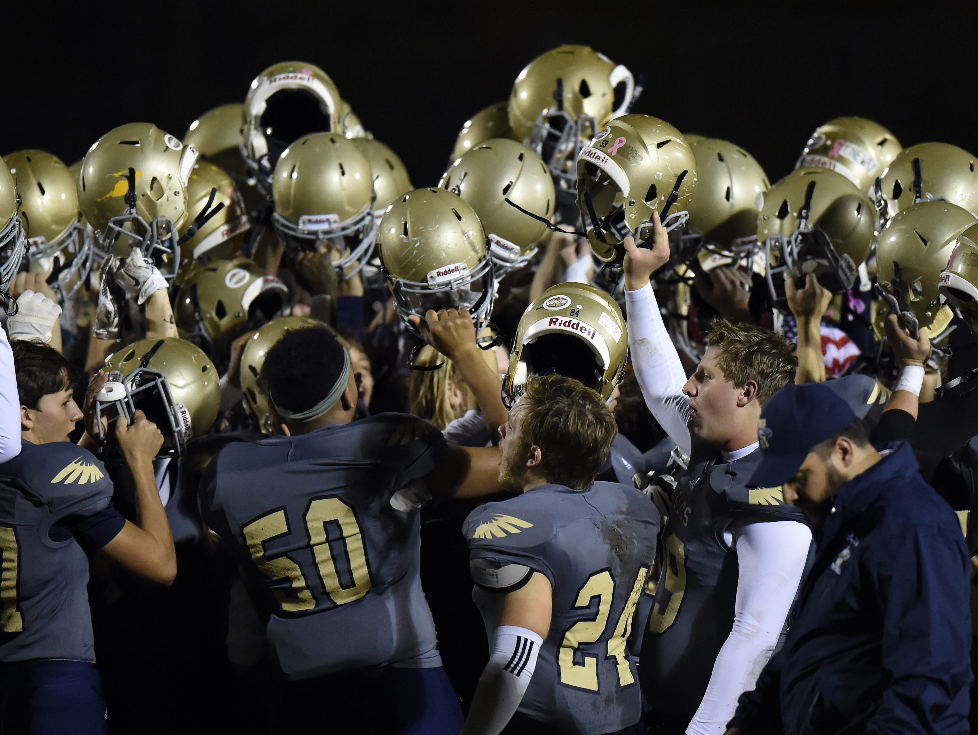 Independence players celebrate a 49-7 win over Cane Ridge in a Class 5A playoff game on Friday. Independence players celebrate their 49-7 win over Cane Ridge in a 5A playoff game Friday.