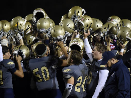 Independence players celebrate their 49-7 opening-round
