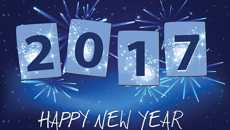 Year 2017 with happy new year on blue fireworks background