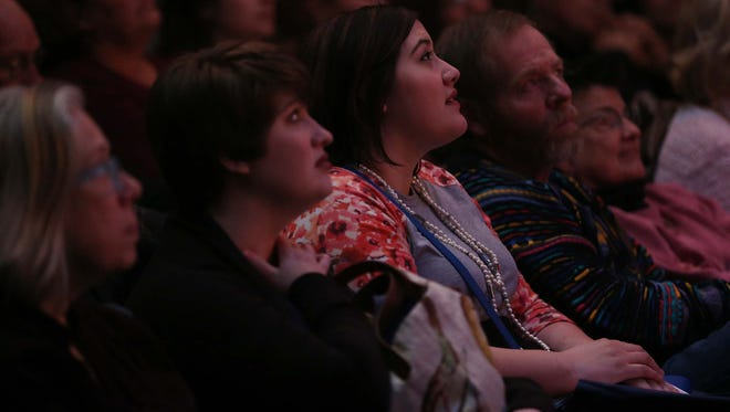 The audience listens as storytellers take the stage during the Des Moines Storytellers Project: Love and Heartbreak event on Tuesday, Feb. 16, 2016, at the Des Moines Playhouse.