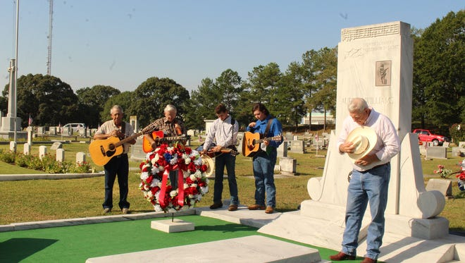 Jeff Petty joins members of the Sheppard family in prayer at the beginning of a tribute to Hank Williams at the Oakwood Annex Saturday. Alvin Benn/Special to the Advertiser
