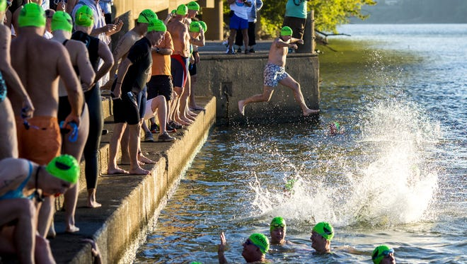 Swimmers start at the Serpentine Wall on Sunday, Sept. 24, 2017, to participate in the Bill Keating, Jr. Great Ohio River Swim.