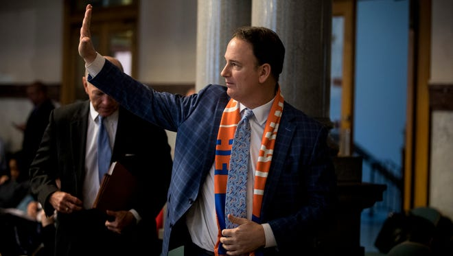 FC Cincinnati general manager Jeff Berding waves to City Council members after City Council passes FC Stadium deal 5-3 to clear the way for MLS bid at City Hall in downtown Cincinnati Wednesday, November 29, 2017.