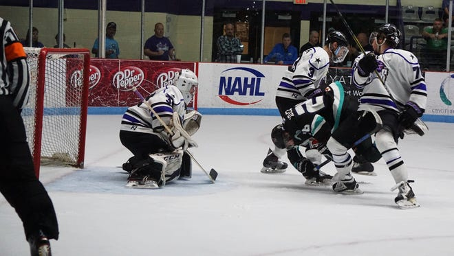 The Shreveport Mudbugs played a contentious game against Lone Star on Saturday. Referee John Lindner (left) was at the center of many disputes.