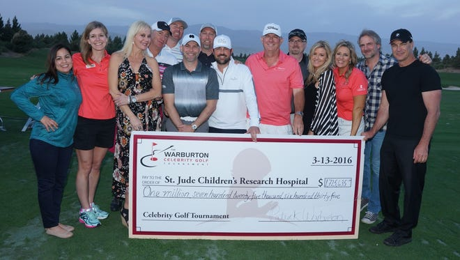 The Coachella Valley-based board of The Warburton Celebrity Golf Tournament presents a check for more than $1.7 million to St. Jude Children's Research Hospital. From left to right: Odette Gutierrez, Jeanie Torchio, Danielle Scardino, John Scardino, Jeff Grady, KC Kinsey, Tad Black, Greg Rubino, chairman Clarke Rheney, Andy Kerr, Kate Spates, Andrea Carter, Andy Childs and Patrick Warburton.