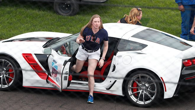 Olympic gold medal-winning swimmer Lilly King gets out of the ceremonial pace car with Sarah Fisher following the start of the IndyCar Grand Prix at the Indianapolis Motor Speedway on Saturday, May 12, 2018.