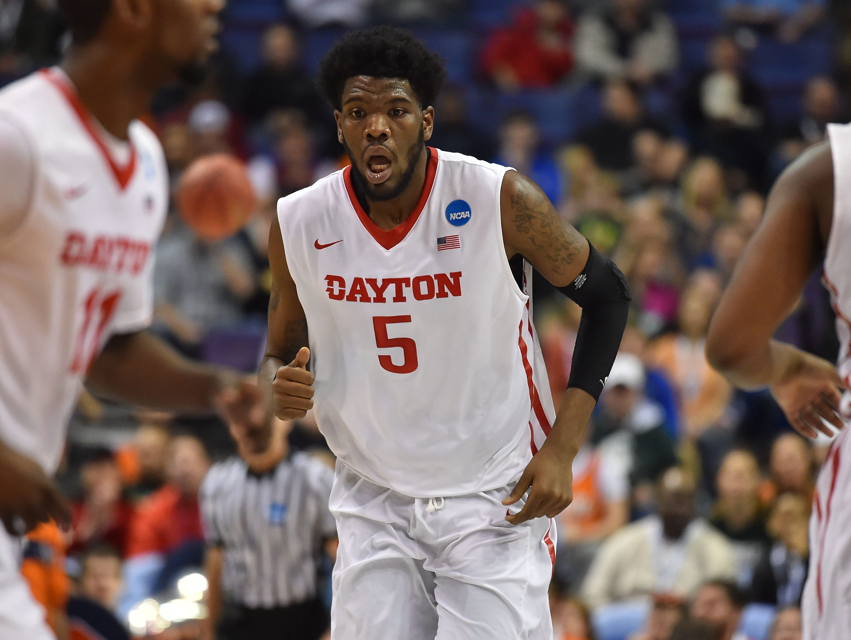 Dayton Flyers center Steve McElvene (5) runs up the court during the first half of the first round against the Syracuse Orange in the 2016 NCAA Tournament at Scottrade Center.