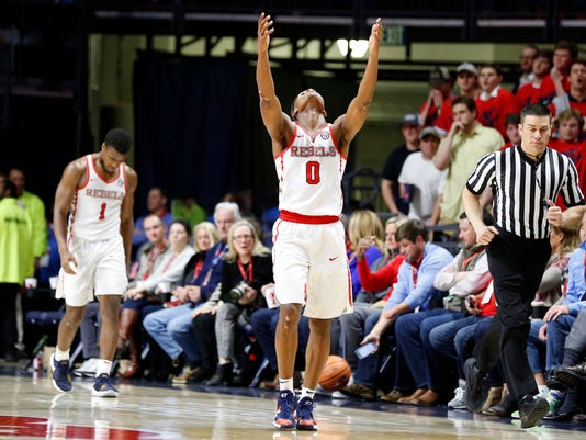 Mississippi guard Devontae Shuler (0) gestures as he and teammate Deandre Burnett (1) go down court during the second half of an NCAA college basketball game against Auburn in Oxford, Miss., Tuesday, Jan. 30, 2018. Auburn won 79-70. (AP Photo/Rogelio V. Solis)