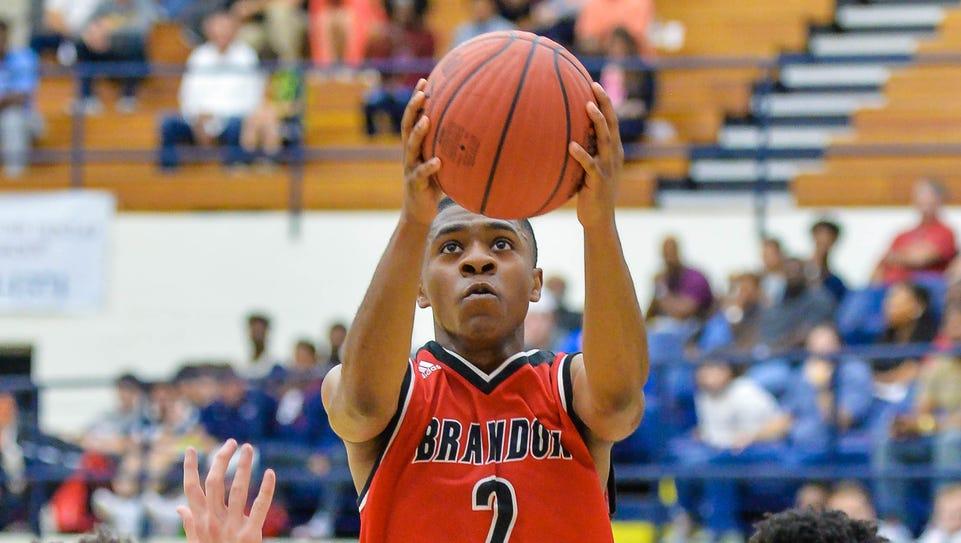 Brandon's Lagarious White (2) drives to the basket