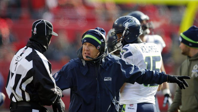 Seattle Seahawks head coach Pete Carroll, center, argues a call in the first half of a Nov. 16, 2014, game against the Kansas City Chiefs in Kansas City, Missouri. The Seahawks played at Kansas City when it was 21 degrees, the coldest game they have played in since Carroll became head coach in 2010.
