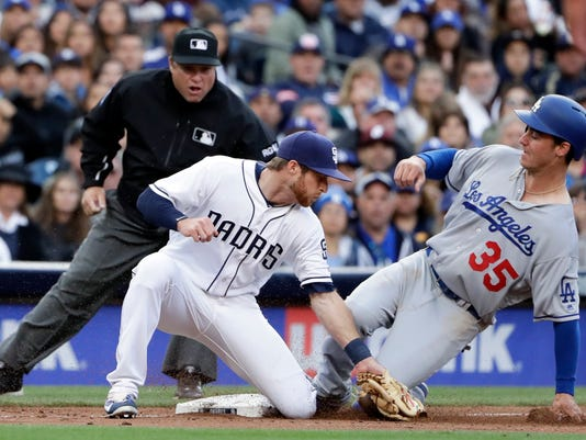 Los Angeles Dodgers' Cody Bellinger (35) safely steals third base as San Diego Padres third baseman Cory Spangenberg is late with the tag during the fourth inning of a baseball game Saturday, May 6, 2017, in San Diego. (AP Photo/Gregory Bull)