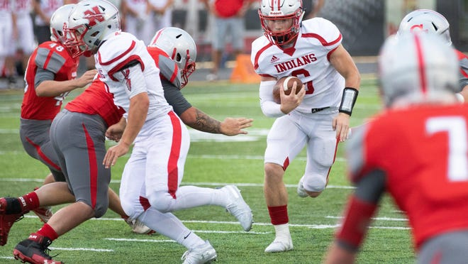 Northwest quarterback Jordan Mick finds a hole to run through during the Indians' win against Canton South during Week 2 of the 2019 season.