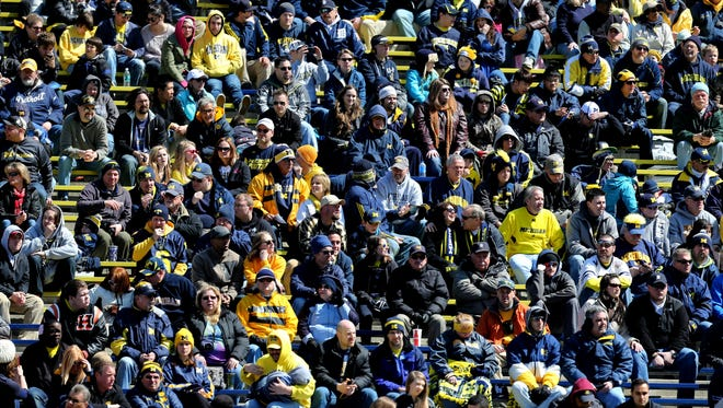Michigan fans watch the spring game on April 5, 2014, at Michigan Stadium in Ann Arbor.