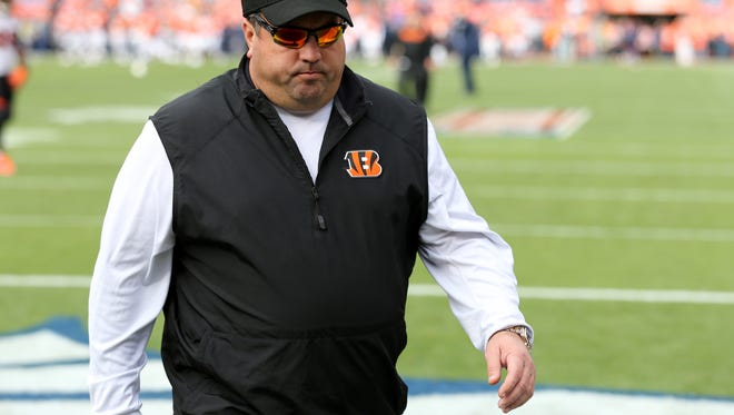Cincinnati Bengals defensive coordinator Paul Guenther walks back into the locker room before the Week 11 NFL game between the Cincinnati Bengals and the Denver Broncos, Sunday, Nov. 19, 2017, at Sports Authority Field at Mile High in Denver, Colorado.