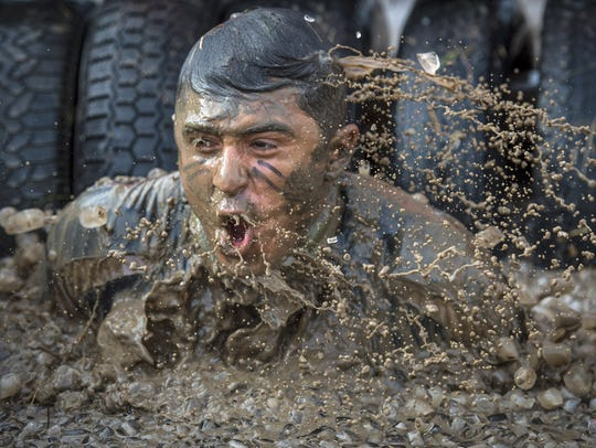 A competitor takes part in the Tough Mudder on Oct.