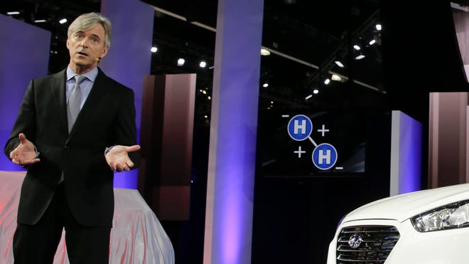 John Krafcik, CEO of Hyundai Motor America, introduces the Tucson Fuel Cell hydrogen-powered electric vehicle at the Los Angeles Auto Show in November