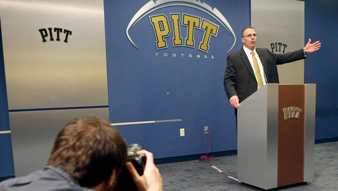 Pat Narduzzi, right, the former longtime Michigan State defensive coordinator, gestures as he speaks Friday at a news conference in Pittsburgh where he was introduced as the new head football coach at the University of Pittsburgh.