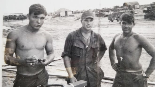 """SPC4 Mike Jones, of Kewanee, center, stands with two of his buddies at Landing Zone """"Betty"""" near Nha Trang, Vietnam, in 1970. On the left is John Boone, of Tennessee, and on the right is Raymond """"Gomer"""" Eich, of Seneca, Ill., with whom Jones has stayed in touch."""