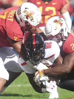 Iowa State's defensive end JaQuan Bailey (3) and linebacker Willie Harvey (2) put the clamps on Texas Tech receiver KeSean Carter (82) during the Cyclones' 40-31 victory over the Red Raiders two years ago at Jack Trice Stadium in Ames, Iowa. Iowa State has beaten Tech four games in a row, holding the Red Raiders to an average of 19.5 points.