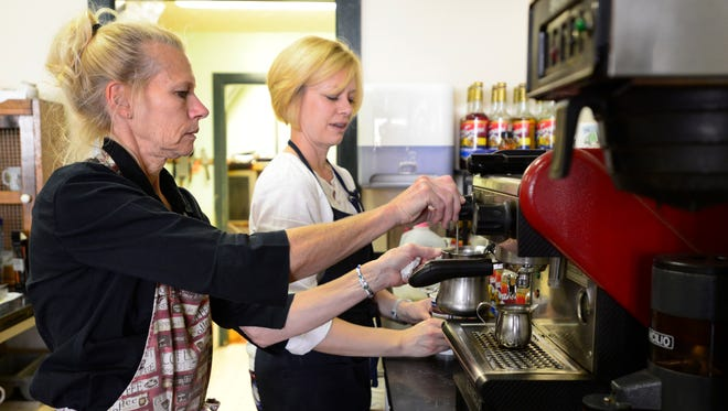 Sue Berlekamp, left, and her daughter, owner Lindi Cahill, make a vanilla latte Cahill Cafe in Clyde.