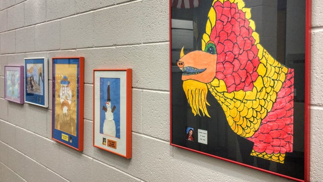 Paintings on the walls of Fremont Elementary School in Carson City will be taken down in spring 2018 after years of display. The school is looking for their creators, so they can give them back.
