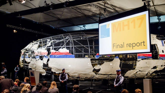 The rebuilt fuselage of Malaysia Airlines Flight MH17 during a press conference to present the report findings of the Dutch Safety Board in Gilze Rijen, The Netherlands, on Oct. 13,  2015.