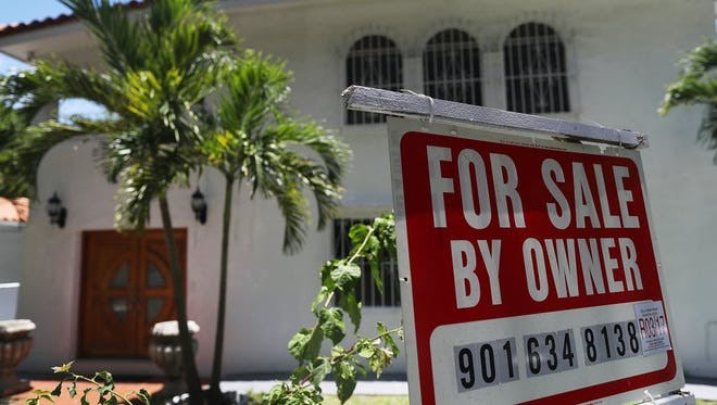A for sale sign is seen in front of a home in Miami, Florida.