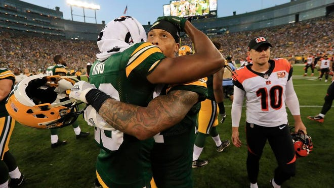Green Bay Packers safety Josh Jones (27) and cornerback Kevin King (20) embrace after the Packers win over the Cincinnati Bengals on Sunday, September 24, 2017 at Lambeau Field in Green Bay, Wis.