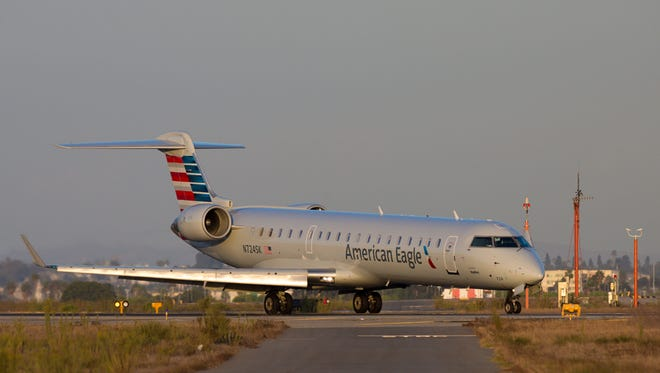 An American Eagle CRJ-700 taxies to the terminal after landing at Los Angeles International Airport on Sept. 23, 2017.