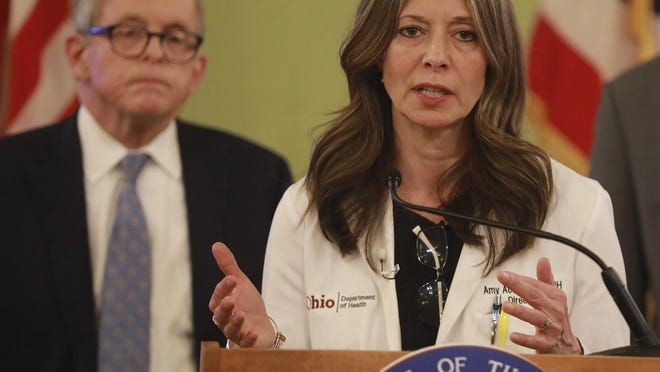 Ohio Department of Health director Dr. Amy Acton at a coronavirus news conference Saturday, March 14, 2020 at the Ohio Statehouse. Behind her is Ohio Gov. Mike DeWine.