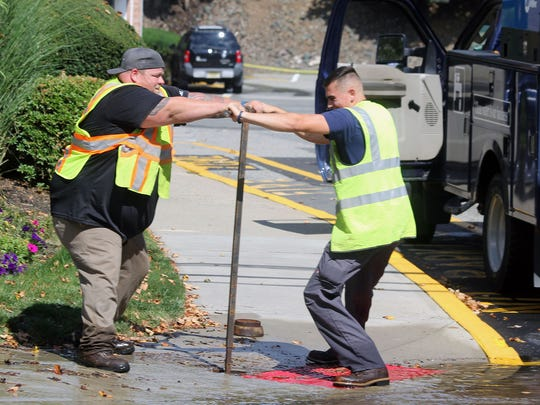 Municipal Authority workers opening up a sewer main
