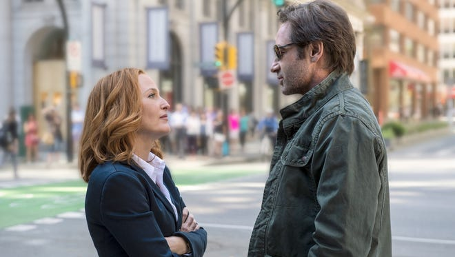Dana Scully (Gillian Anderson) and (Fox Mulder (David Duchovny) reunite in the six-episode revival of 'The X-Files,' premiering on Fox in January.
