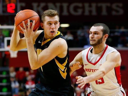 Jake Dadika defending for Rutgers