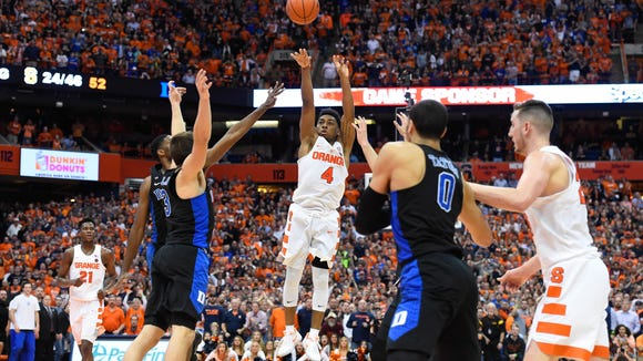john Gillon (4) lets fly with his game- winning shot in the final seconds against Duke in a 78-75 victory on Wednesday in front of 30,331 fans at the Carrier Dome.