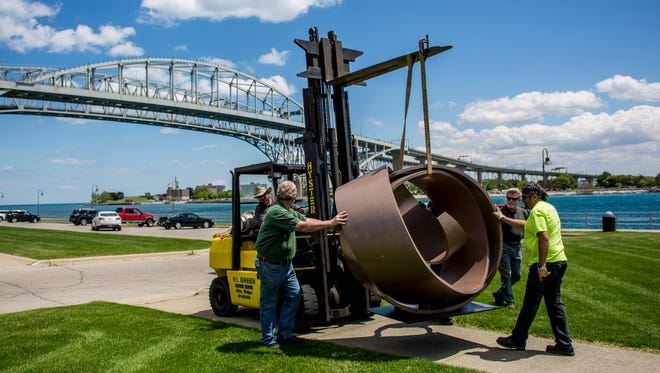 A sculpture is moved with a forklift before being installed along Thomas Edison Parkway as part of The Port Huron Art Initiative sculpture exhibition. 20 sculptures will be installed, and a kick-off event will be held Saturday from 2 p.m.- 10 p.m.