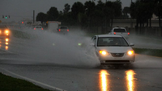 A rainy ovecast Thursday morning made driving tough for some drivers