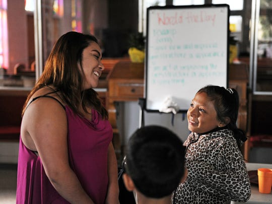 From left, Program Director Anahi Alcibar and student Karla Galan, 8, share some time together at the L.I.F.E. after-school program in east Salinas.