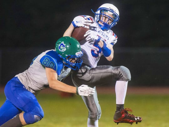 Colchester's Jake McDonald, left, tackles Mt. Anthony's