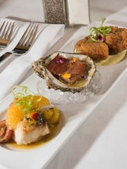 "Chef Jason Perry from Jackson's Steakhouse created a dish he calls  ""A Trio of Gulf Seafood"" — pan-roasted snapper with heirloom tomatoes and Florida citrus meunière; fried grouper cheeks with Dijon-lime aioli; and chargrilled oyster with roasted garlic compound butter and small-batch bacon."