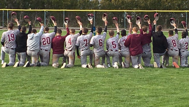 Members of Greece Arcadia's baseball team remember principal Lesley Flick Saturday.