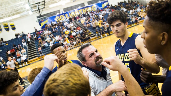 Naples High School coach Pierre Eaton talks to the team during a timeout during the Class 7A regional semifinal at Lehigh Senior High School on Tuesday, Feb. 27, 2018.