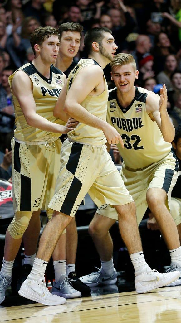 Purdue teammates of Dakota Mathias react after he drains