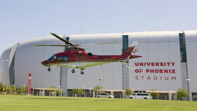 Arizona Cardinals Patrick Peterson arrives at University of Phoenix Stadium in Glendale by helicopter on July 28, 2016.
