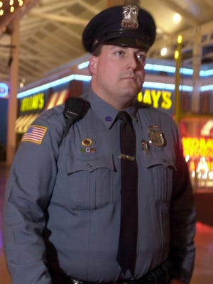 In this 2004 file photo, Clarkstown Police Officer Robert McDonald patrols the Palisades Center mall in West Nyack, N.Y. He's a detective now who while on vacation helped Ocean City, Md., police catch a carjacker.