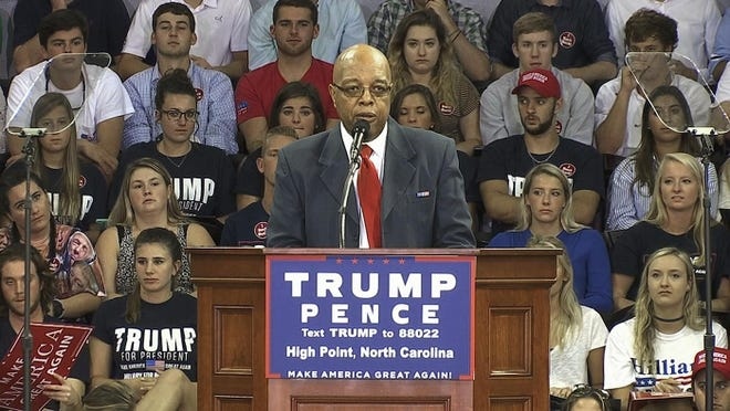 In this Tuesday, Sept. 20, 2016, image made from video, Clarence Henderson, a participant in the Feb. 1, 1960, sit-in at a Greensboro, N.C., Woolworth lunch counter, speaks at a campaign event in High Point, N.C., in support of Republican presidential candidate Donald Trump.