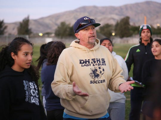 Scott Saban, Desert Hot Springs High School girls soccer coach, talks with his team November 28, 2016.