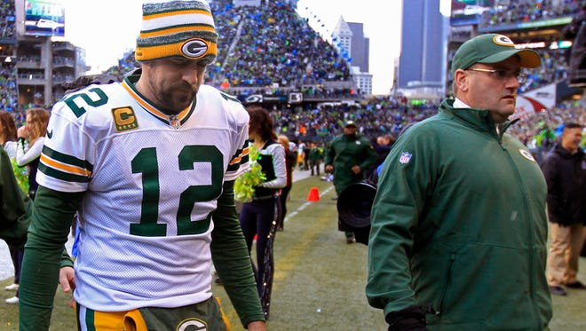 Aaron Rodgers leaves the field following the Green Bay Packers' 28-22 overtime loss to Seattle in the NFC championship game on Jan. 18.