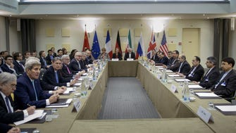Iranian Foreign Minister Javad Zarif, center right, European Union High Representative Federica Mogherini, center left, and other officials from Britain, China, France, Germany, Russia and the United States wait for the start of a meeting on Iran's nuclear program at the Beau Rivage Palace Hotel in Lausanne, Switzerland, March 31.