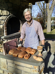 Pastor Bryce Johnson baking bread in the community oven. Johnson presented the idea for the community oven and the White bear Lake United Methodist Church congregation built it.