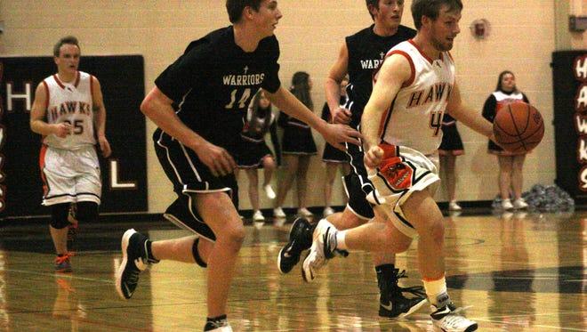 Huron Valley Lutheran's Jordan Runstadler pushes the ball up court during a game earlier this season.